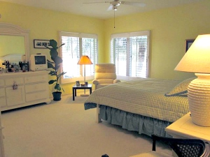 Spacious master bedroom features an adjacent master bath and a HUGE walk in closet.