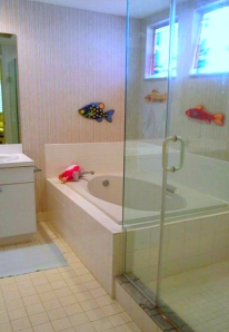 Master bath has soaking tub and a new shower door.